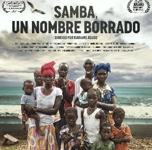 """Presentación, proyección y debate del documental """"Samba, un nombre borrado"""". Grupo personas de color y niños de diferentes edades."""